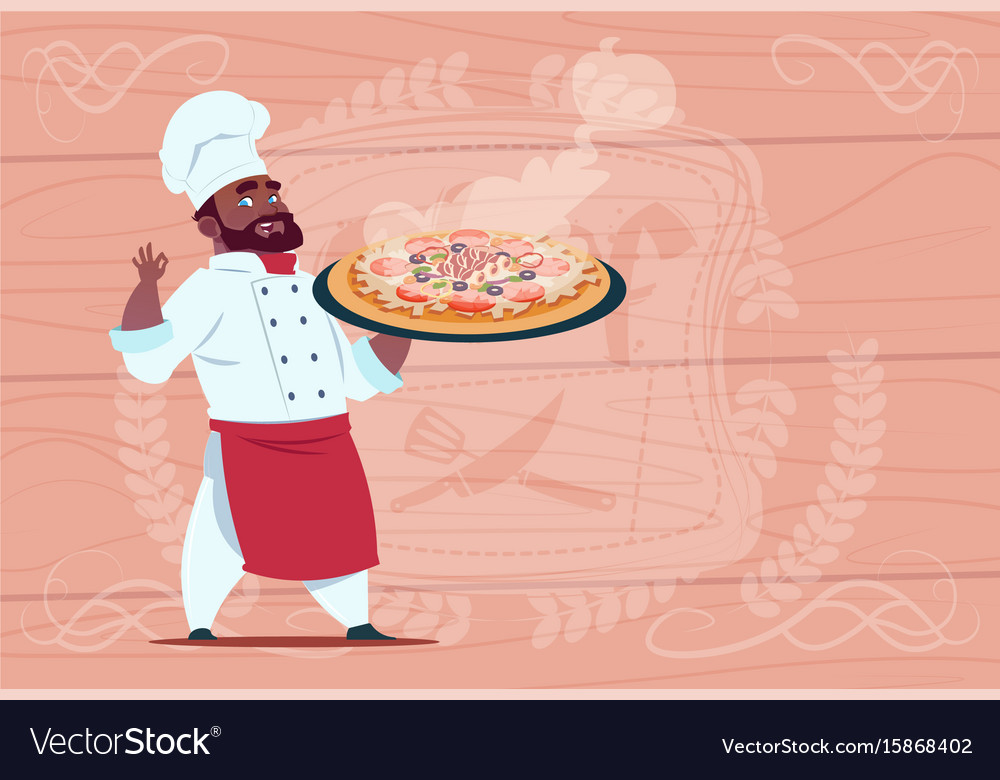 African american chef cook holding pizza smiling