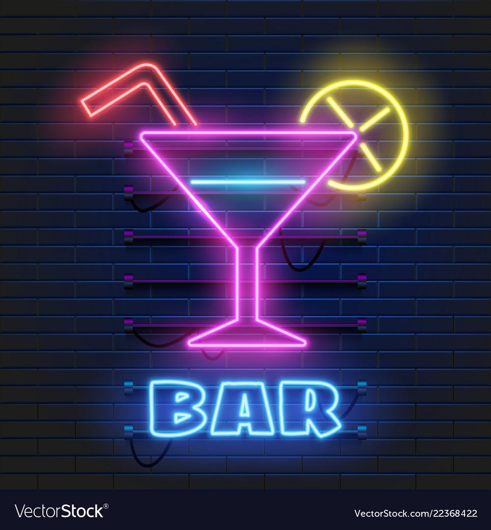 Neon cocktails bar sign on dark brick wall