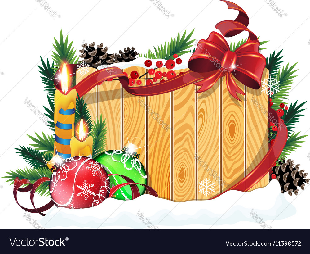 Baubles and candles on wooden background