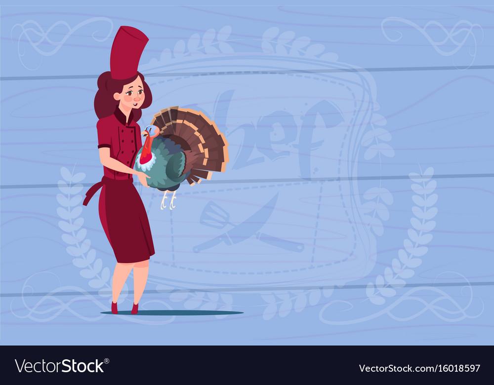 Female chef cook holding turkey cartoon chief in