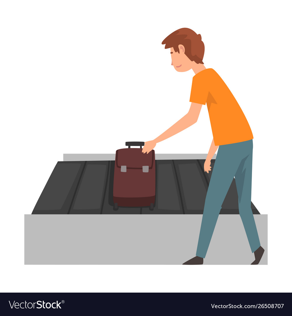Young man picking up his suitcase on luggage