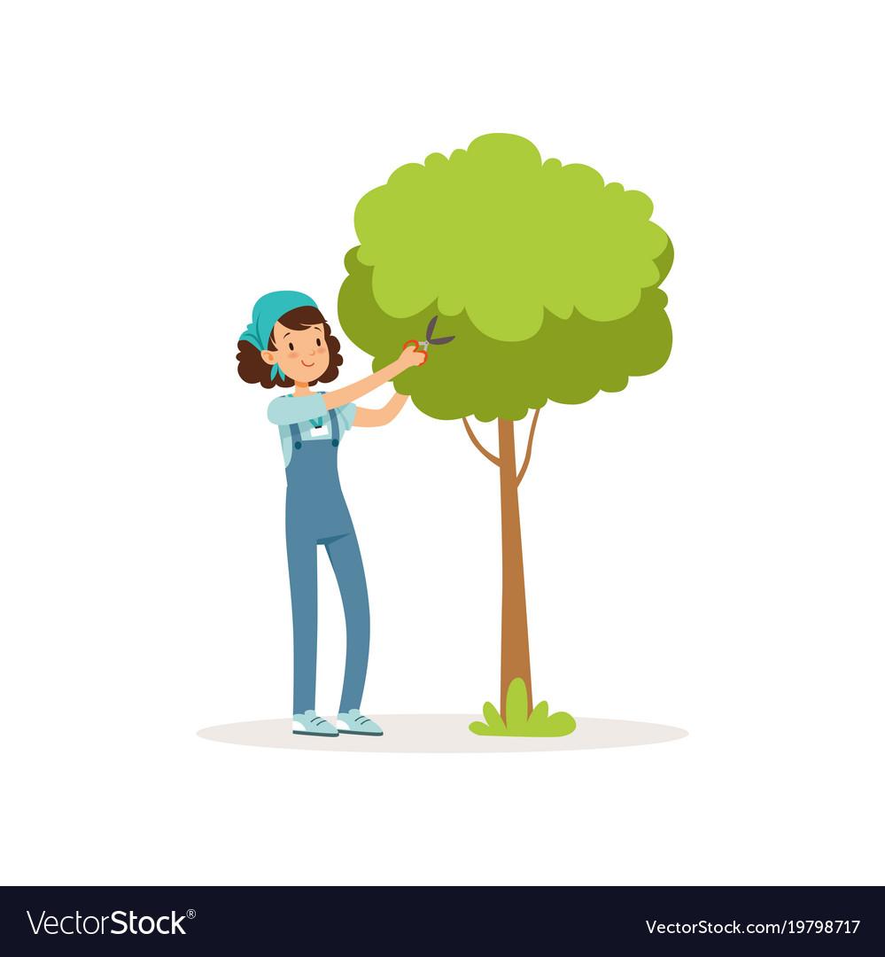 Girl cutting green tree using garden scissors