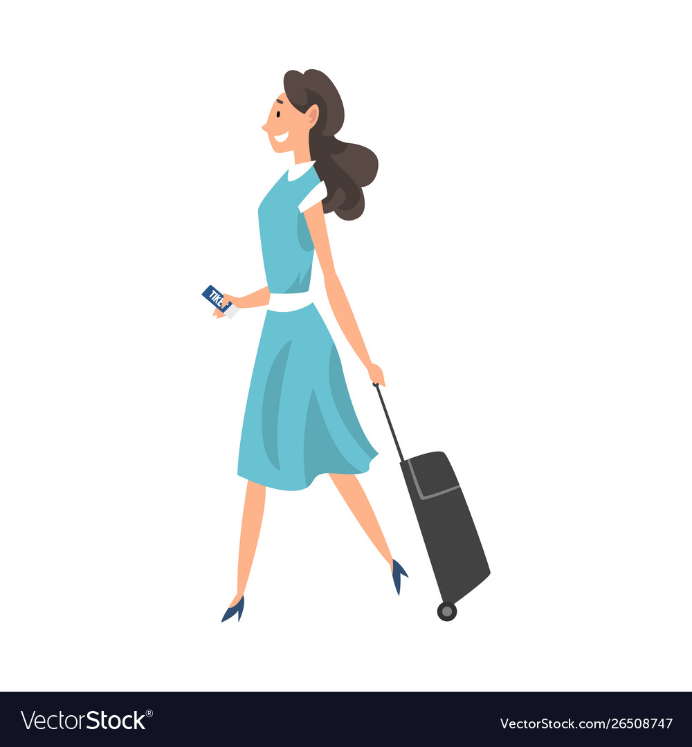 Young brunette woman walking with suitcase on