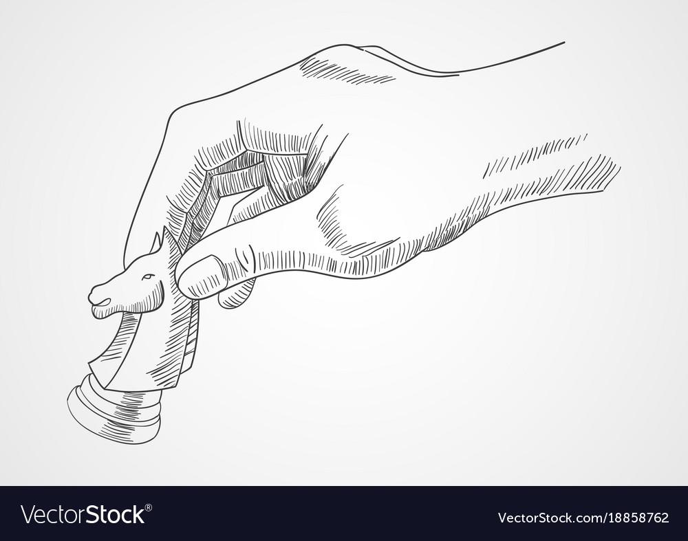 Human hand holding chess knight piece