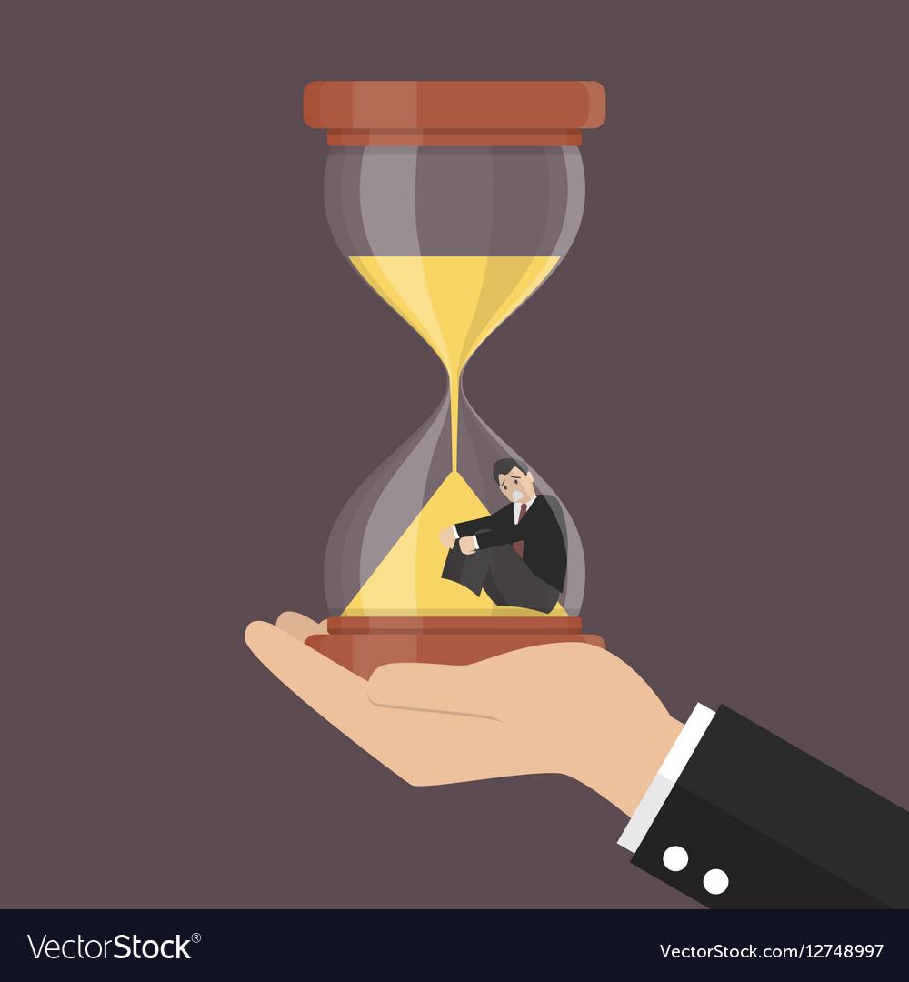 Small businessman stuck in sandglass vector image