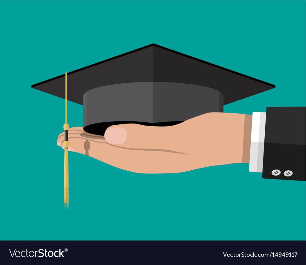 Academic graduation cap in hand student hat