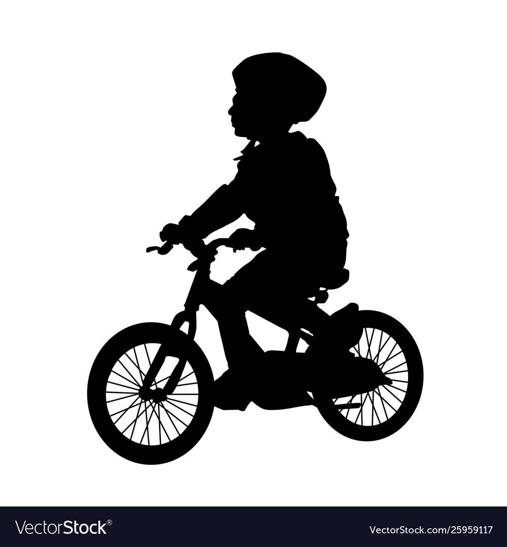 Little boy silhouette riding a bike