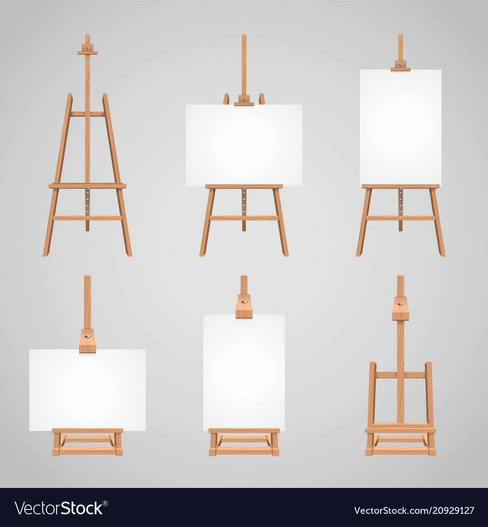 Set of canvases standing on wooden