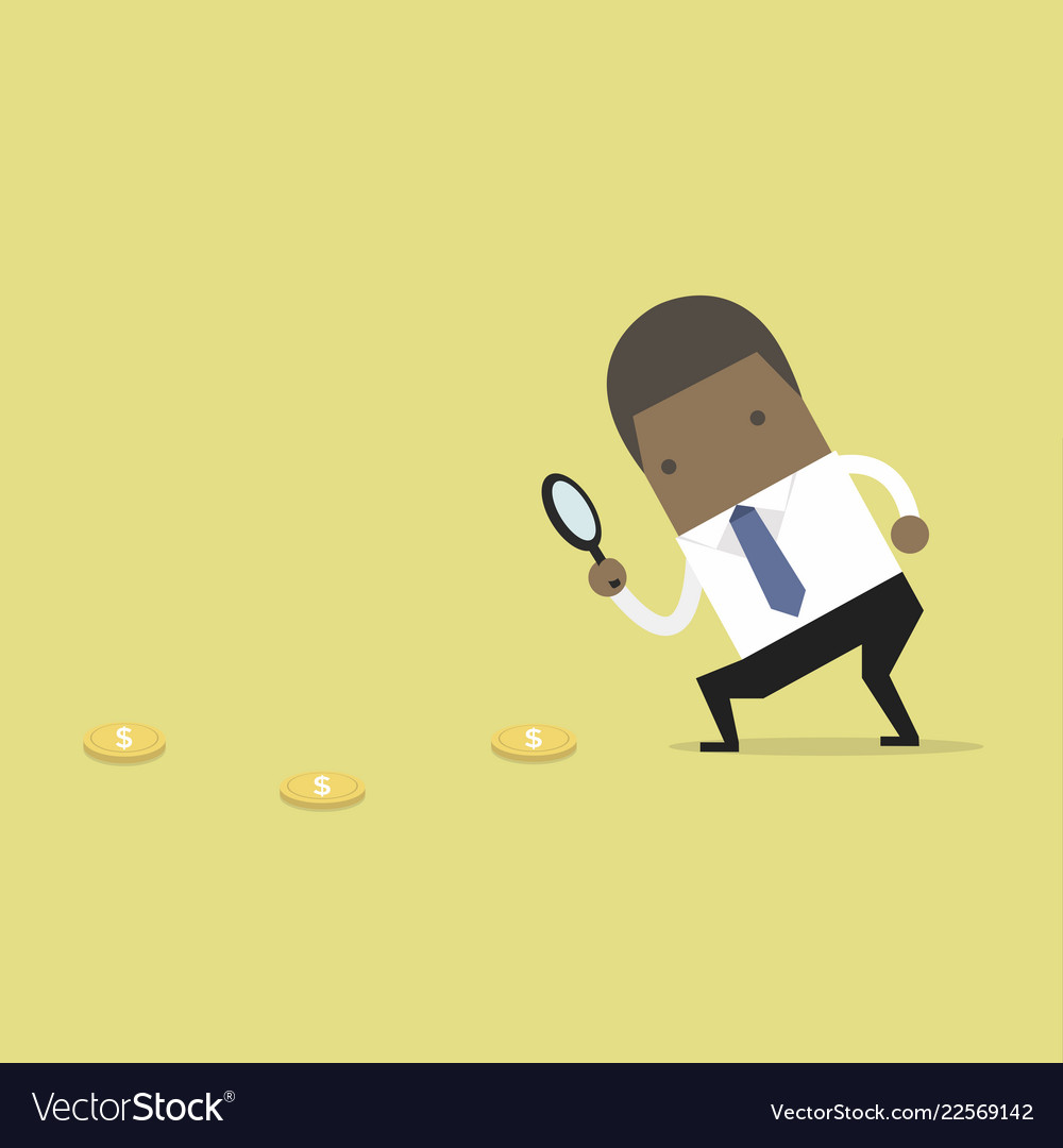 Businessman holding a magnifying glass find coins