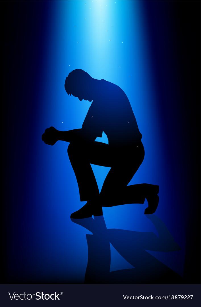 Silhouette of a man praying