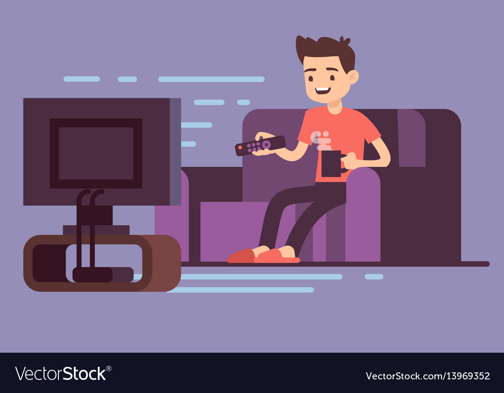 Man watching tv and drinking coffee on sofa in