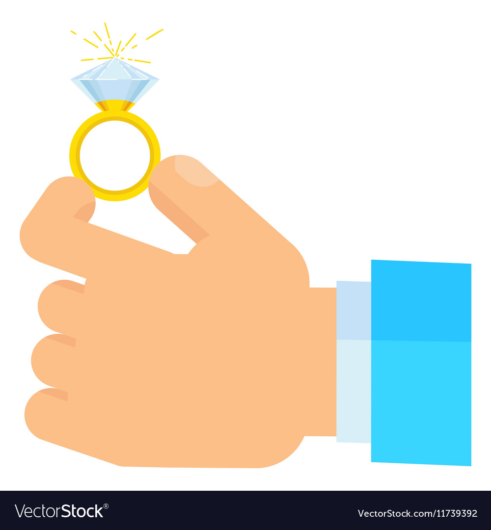 Hand holding wedding rings