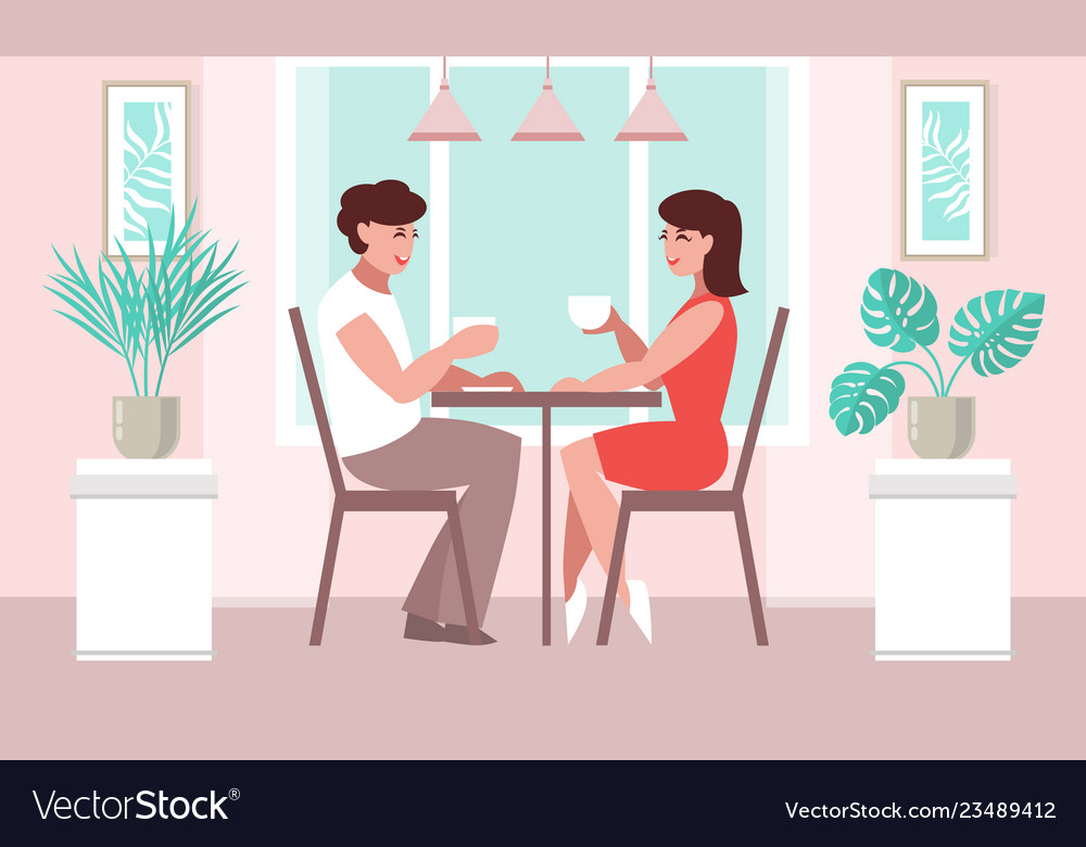 Lovers woman and a man at a table in a cafe