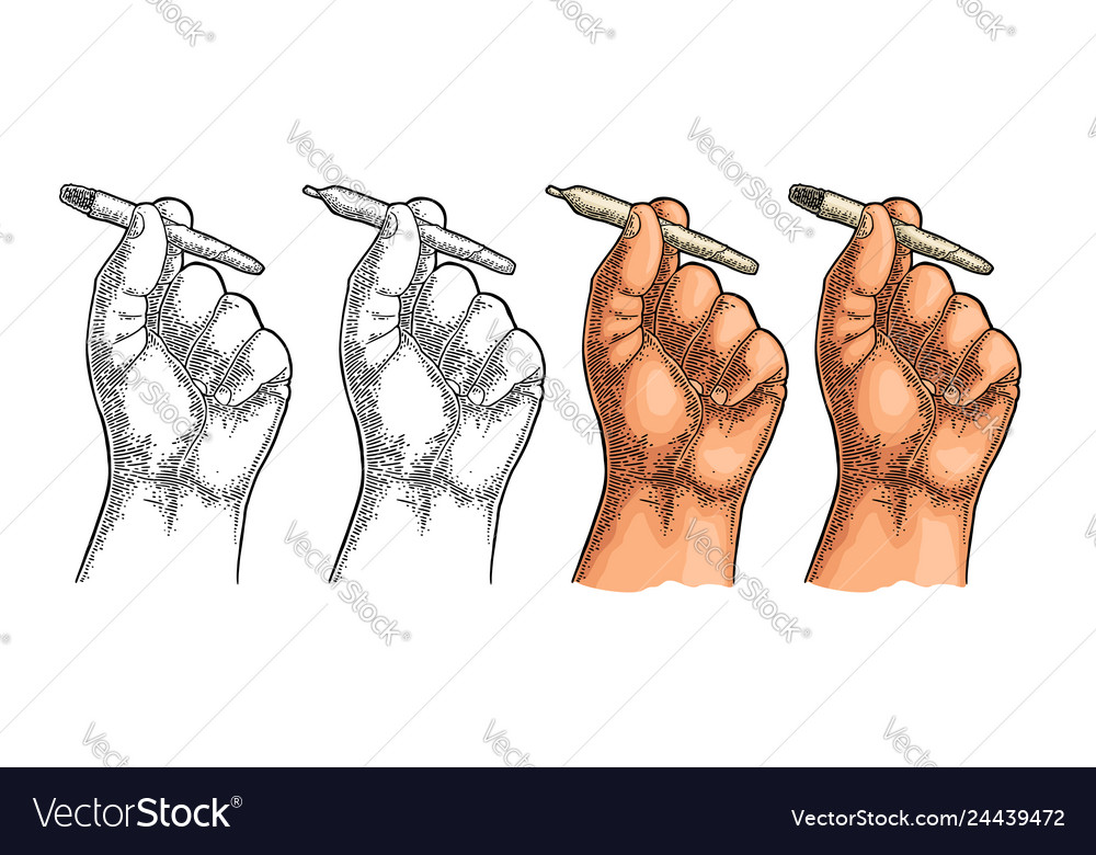 Male hand holding burning cigarettes with
