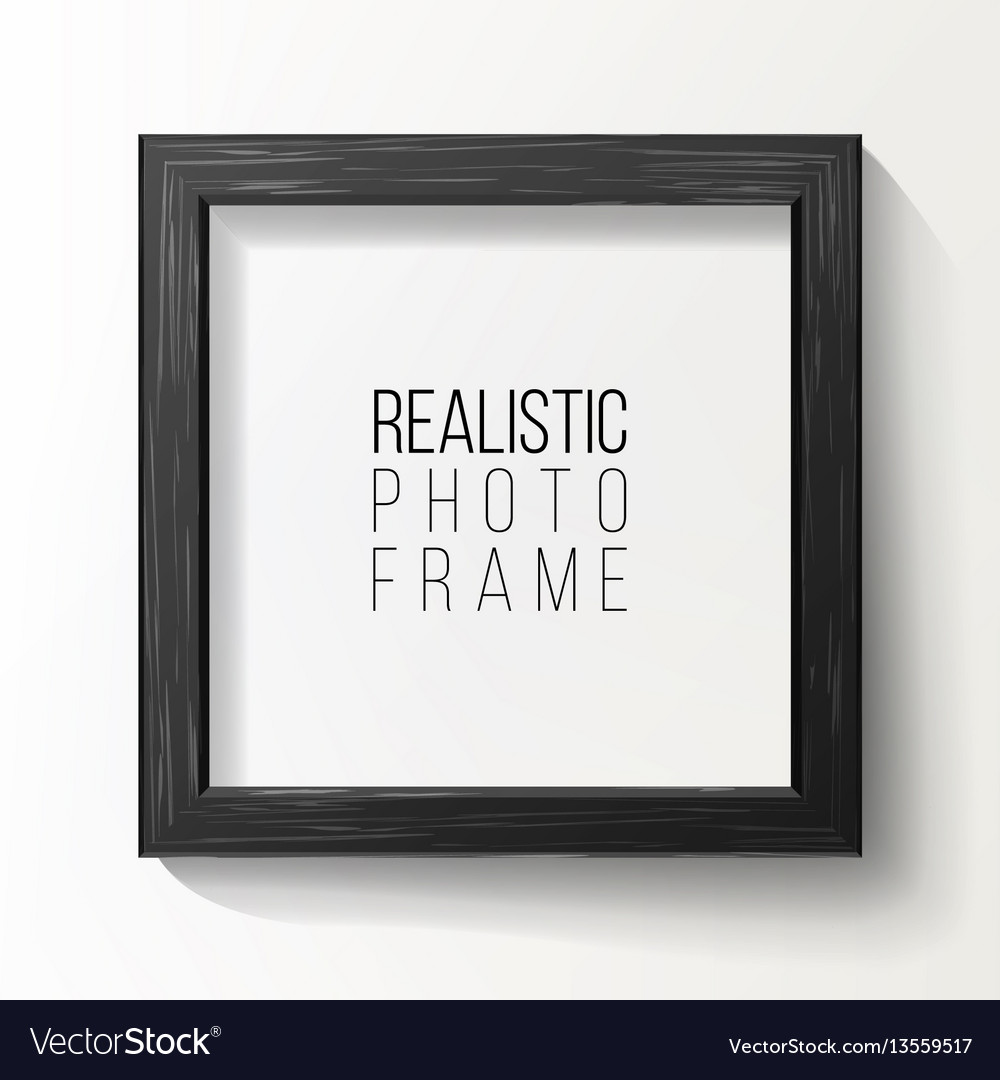 Realistic photo frame on white wall from
