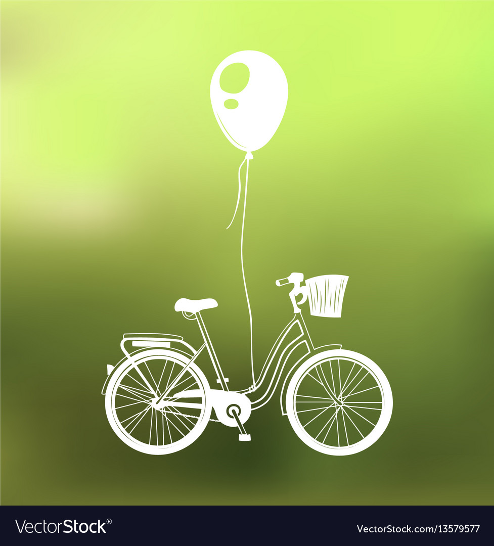 Retro bicycle with air balloon isolated on green