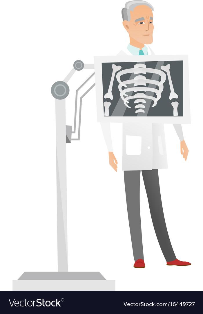 Caucasian roentgenologist during x ray procedure
