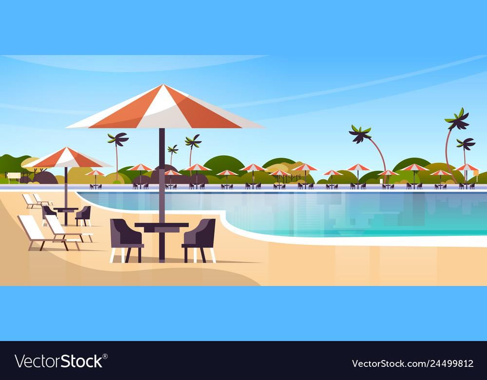 Luxury hotel swimming pool resort with umbrellas