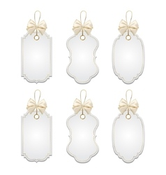 Set of elegant tags with silver and golden bows vector image vector image