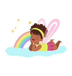 Cute little girl with wings lying on her stomach vector