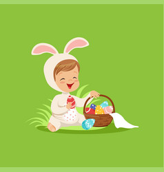 Cute little boy in a white bunny costume sitting vector