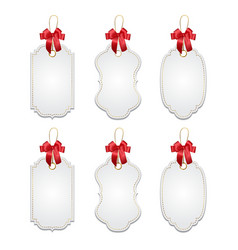 Set of elegant tags with red bows vector image