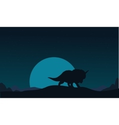 Silhouette of triceratops and big moon scenery vector