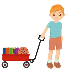 Young happy little boy playing with red wagon vector