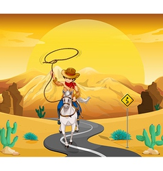 A cowboy riding on a horse travelling through the vector image vector image