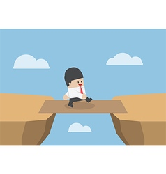 Businessman cross the cliff gap by wooden board as vector image vector image