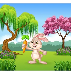 Cute bunny holding carrot in the jungle vector