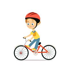 Happy little boy in helmet riding bicycle vector