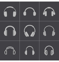 black headphone icons set vector image