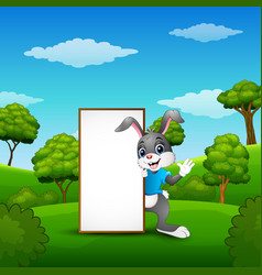 Cartoon bunny waving hand with blank sign in the p vector