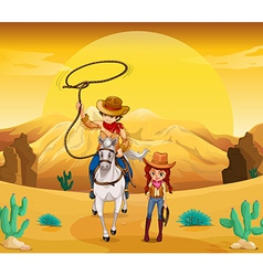 A cowboy and a cowgirl at the desert vector image