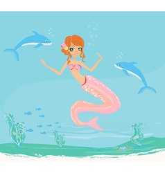 a Beautiful mermaid with dolphins under water vector image