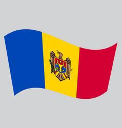 Flag of moldova waving on gray background vector