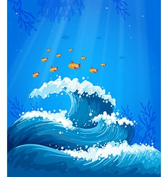 A wave and fishes under the sea vector