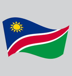 flag of namibia waving on gray background vector image