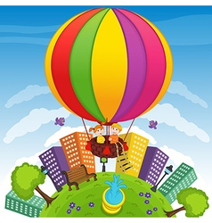 boy and girl on hot air balloon vector image vector image