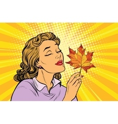 Girl and autumn a woman with red maple leaf vector