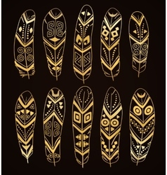 Hand drawn golden ethnic feathers set vector