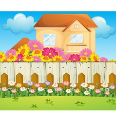 A house with blooming flowers vector image