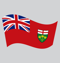 Flag of ontario waving on gray background vector