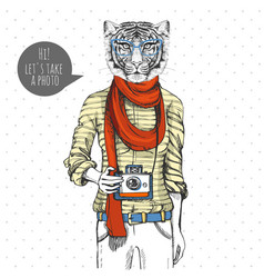 Retro hipster animal tiger with photo camera vector