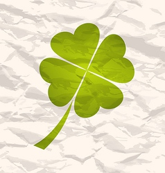Clover with four leaves on crumpled paper vector image