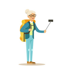 Active senior woman with backpack making selfie on vector