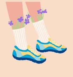 Female legs in sneakers vector