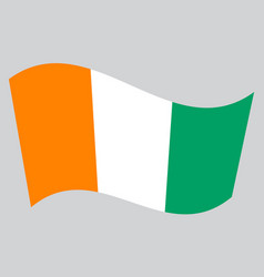 flag of ivory coast waving on gray background vector image