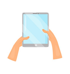 human hands holding gray tablet computer modern vector image